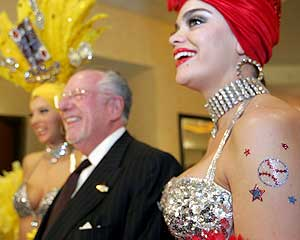 Mayor Oscar Goodman and showgirls