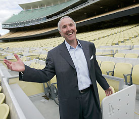 Frank McCourt with the newly renovated pastel seats in Dodger Stadium